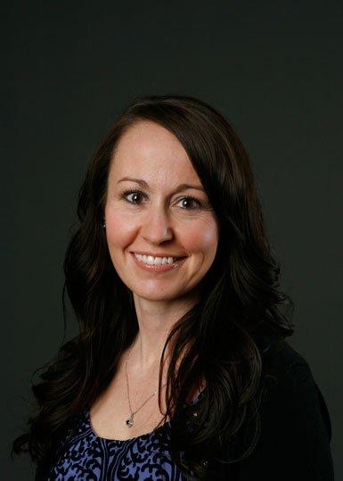 Heather, a pediatric nurse, smiling.