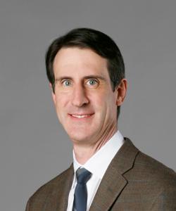 Dr. Piller, an orthopedic surgeon, smiling