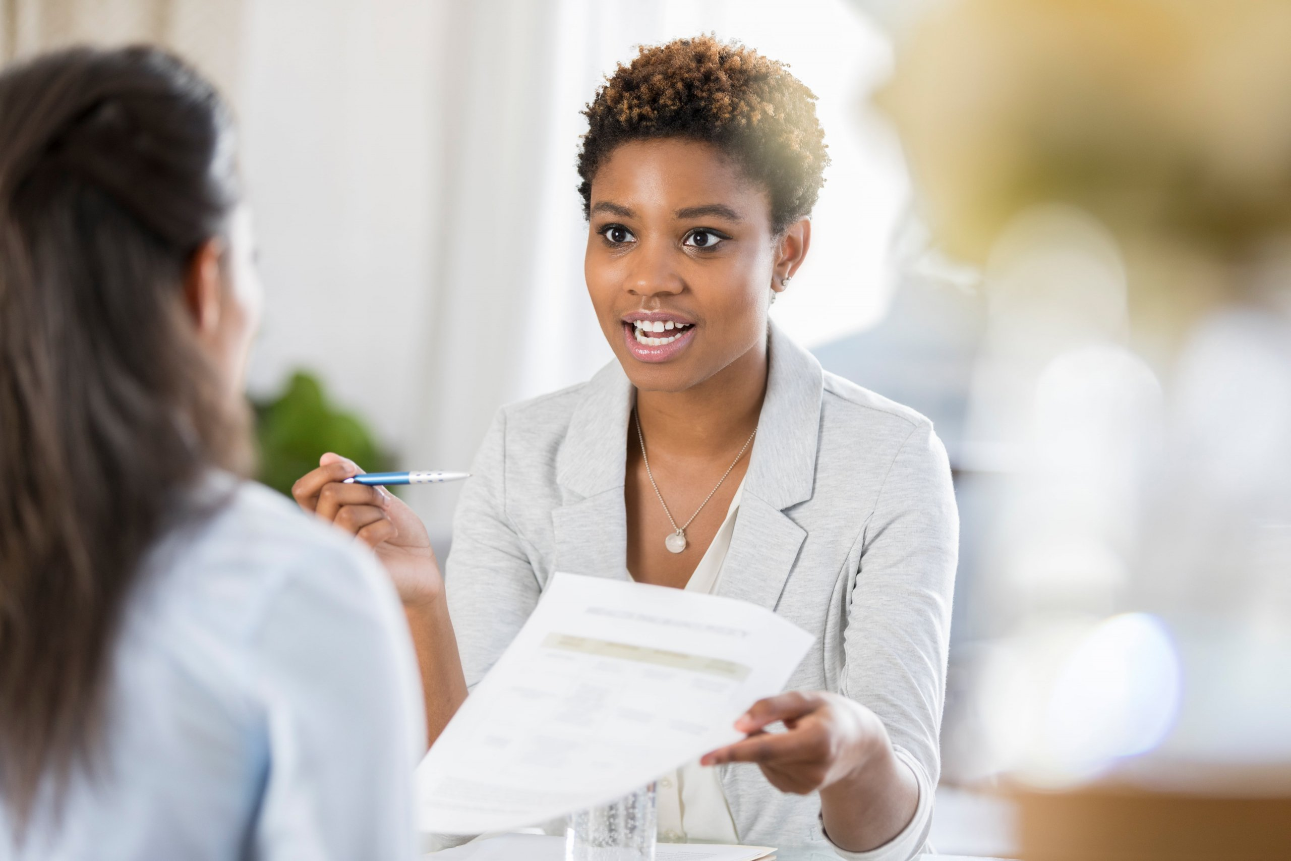 young woman discussing finances